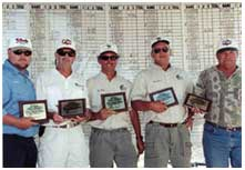 Fishing tournament winners holding their awards