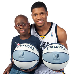 Memphis Grizzlies player Rudy Gay with a St. Jude patient.