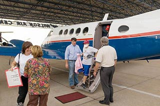 A patient from the devastated Gulf Coast region arrives in Memphis on Tuesday, September 6.
