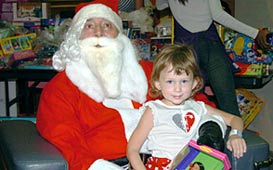 Joe Farris as Santa with a St. Jude patient